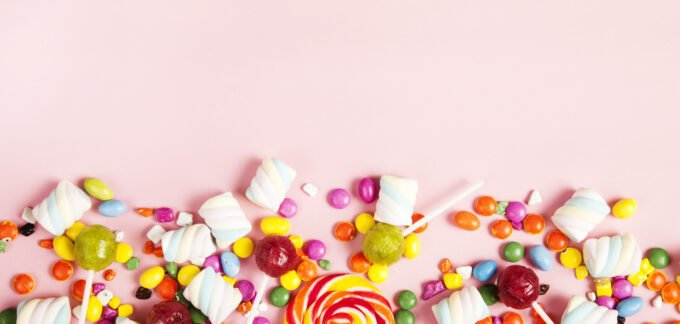 colorful candy on pink background