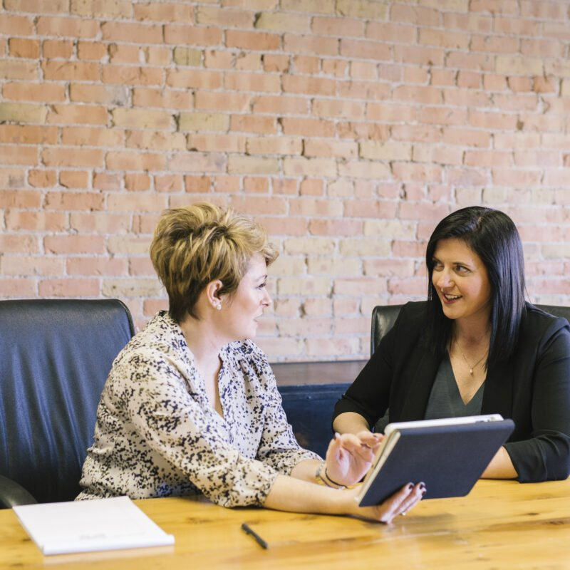 woman coaching another woman in a nice office