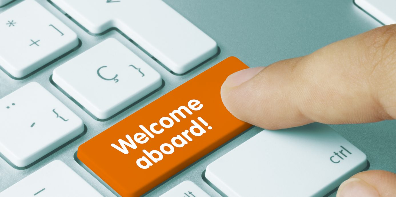 """Computer with a key that says """"Welcome Aboard!"""""""